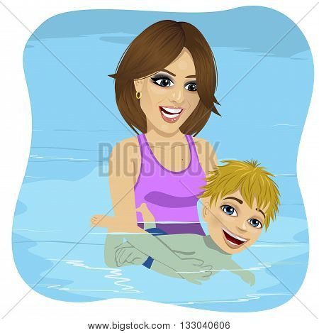 Little boy learning to swim in a swimming pool, mother holding the child