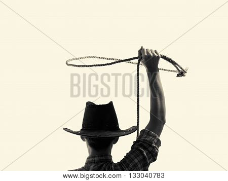 cowboy throws a lasso on the isolated background