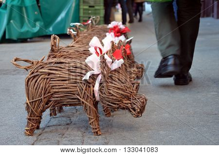 Selling fortune pig on street market in Salzburg (Austria)