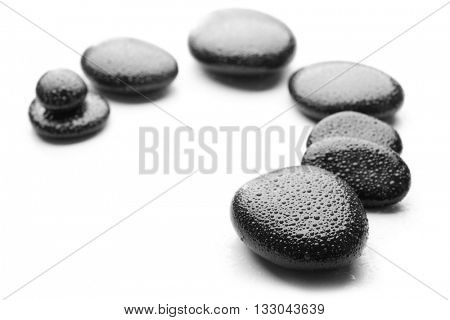 Heap of spa hot stones isolated on white