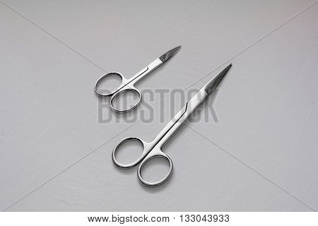 Various scissors on white background Professional tools