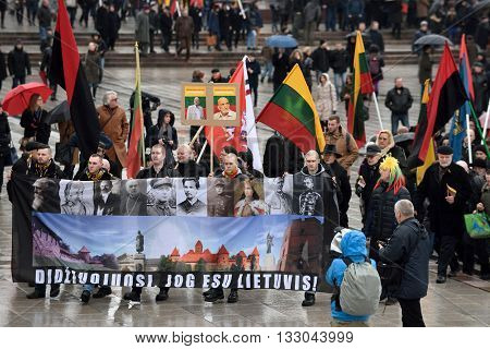VILNIUS LITHUANIA - MAR 11: Around one thousand people gathered with flags in a nationalist rally at Gedimino Avenue on Re-Establishment of Independence Day on March 11 2016 in Vilnius Lithuania