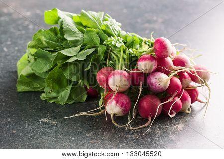 Bunch of fresh radishes. Fresh radishes on old kitchen table.