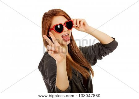 Young teenage woman wearing sunglasses