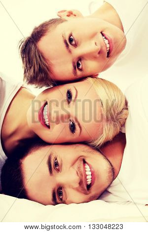 Happy friends together- one woman and two men