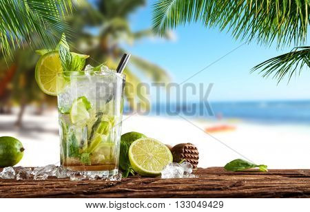 Summer cocktail with blur beach on background