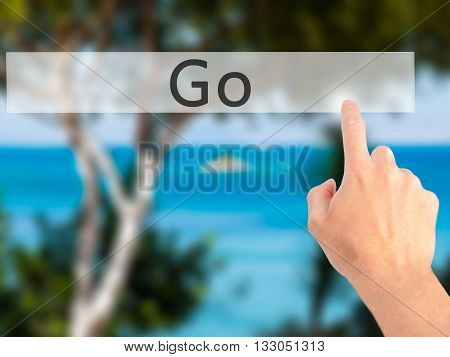 Go - Hand Pressing A Button On Blurred Background Concept On Visual Screen.
