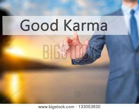 Good Karma - Businessman Hand Pressing Button On Touch Screen Interface.