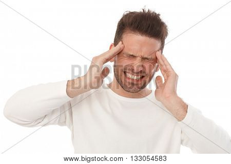 Young man having horrible headache, painful facial expression.
