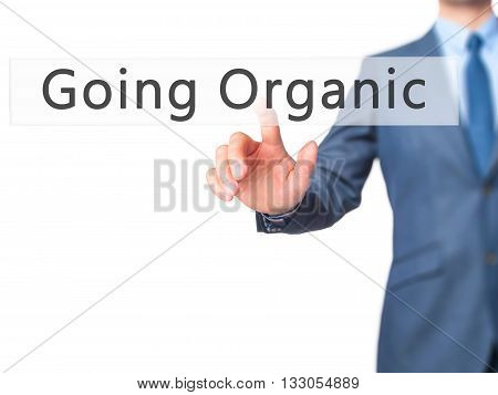 Going Organic - Businessman Hand Pressing Button On Touch Screen Interface.