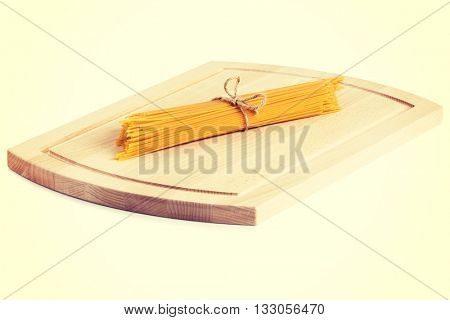 Raw pasta on wodden board
