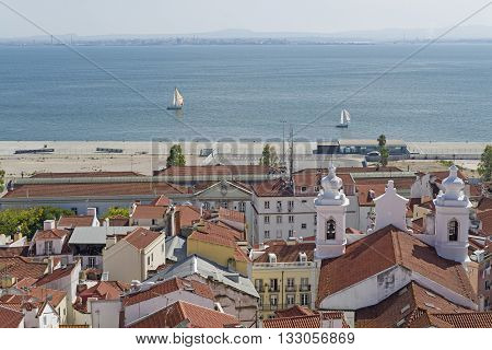 Aerial view of Alfama district with the river Tagus in Lisbon Portugal