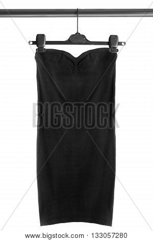 Black dress on clothes rack isolated over white