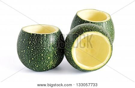 Three eight ball squash with cut tops and scooped out pulp isolated on white.