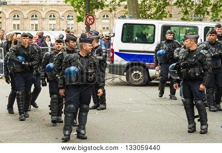Paris France-June 04 2016 : The anti riot policemen during Tropical carnival in Paris France.