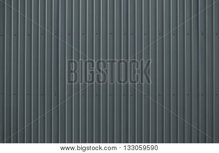 Texture of gray metal roofing wth bolts