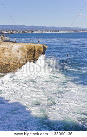 Peaple watching surfers in Santa Cruz beach