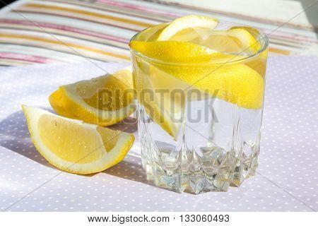 freshness concept homemade lemonade Summer detox drink lemon in glass jars. Fresh water refreshment drink