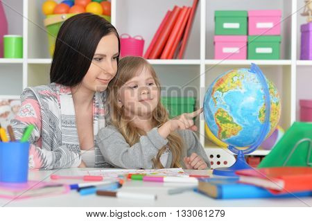 Elementary school  class with beautiful teacher and little girl
