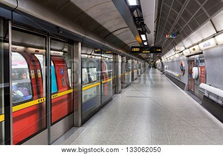 LONDON - FEBRUARY 08, 2016: View from platform of red high speed subway train station behind closed doors. London, UK on February 08, 2016.