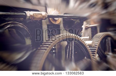 SCIENCE MUSEUM, LONDON - FEBRUARY 08, 2016: Various iron gears and pistons with blurry dark edges as concept about motion and force. London, UK on February 08, 2016.