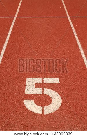 The number 5 on a running track
