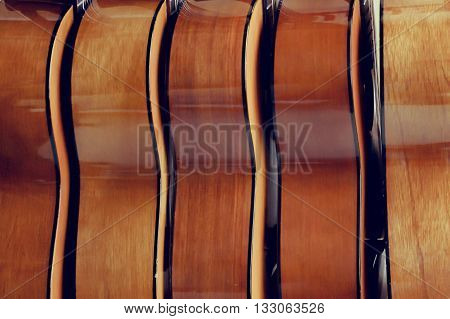Beautiful skin tone of guitars. Side view of guitars. Guitars stacked.