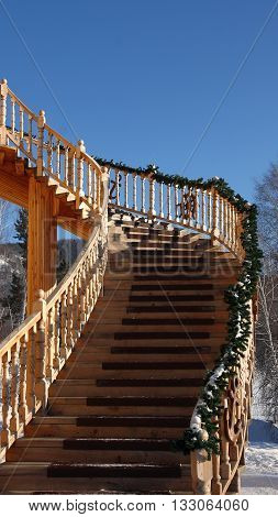 Wooden stairs with a handrail rise to the second floor.