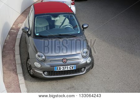 Monte-Carlo Monaco - May 17 2016: Fiat 500 Convertible Car Parked in Front of the Fairmont Monte Carlo Hotel in Monaco