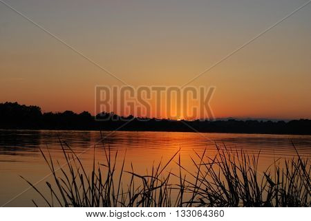 sunset over the river, one of the most beautiful natural phenomena
