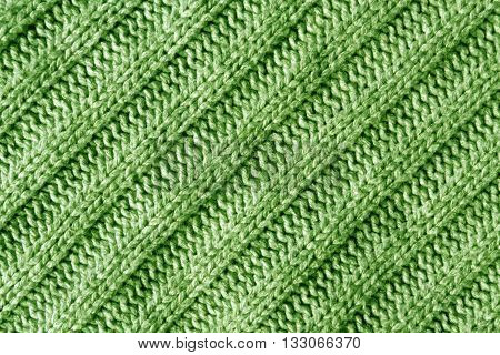 Abstract Green Knitted Cloth Texture.