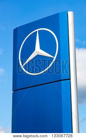 SAMARA RUSSIA - MAY 22 2016: Official dealership sign of Mercedes-Benz over blue sky. Mercedes-Benz is a German automotive manufacturer