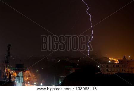 Lightning falling rainy weather in Bangkok Thailand.