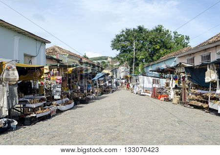 TRINIDAD - DECEMBER 3: Souvenir stalls on the old colorful street on 3 December 2015 in Trinidad, Cuba. City of Trinidad is a UNESCO World Heritage Site