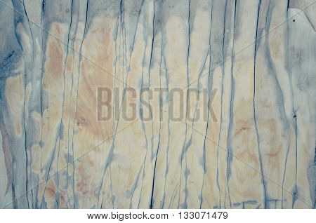 background texture of old grunge plywood with peeling lacquer