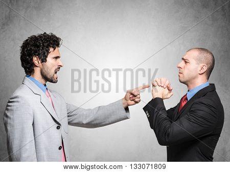 Boss firing a supplicating employee