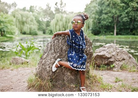 Cute African American Baby Girl At Sunglasses