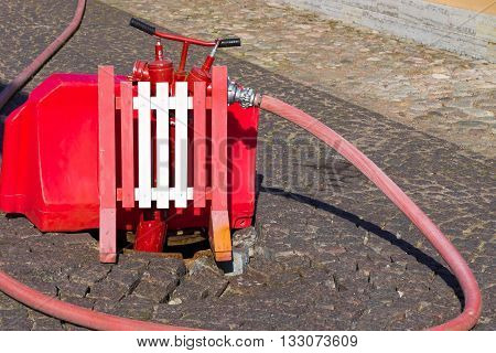 fire fighting equipment on the city street in a water intake zone from an underground water supply system closeup