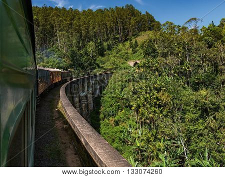 Train passing over Nine Arches Bridge in Demodara Sri Lanka. One of major tourist attraction in Sri Lanka