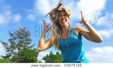 dissatisfied blonde woman with tangled hair drone