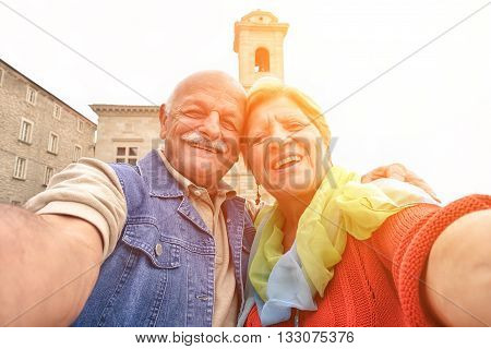 Senior couple taking a selfie in old town center