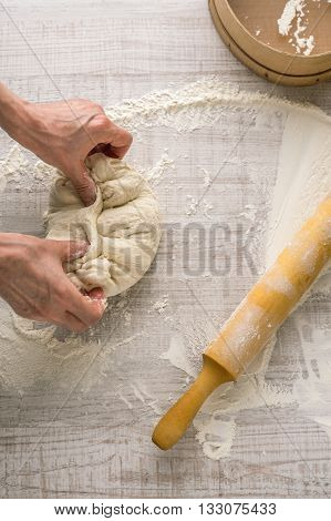 Process of preparing the dough hands a rolling pin sieve vertical
