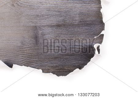 Closeup of torn white paper revealing dark wooden surface. Mock up