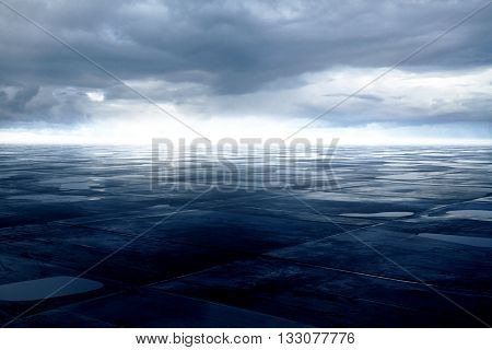 Blue grunge ground with small puddles under cloudy sky. 3D Rendering