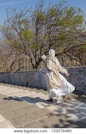 Palitana, India - March 6, 2016: Jain nun on parikrama, walking pilgrimage, to Jain temples on top of Shatrunjaya hill, Palitana (Bhavnagar district), Gujarat, India