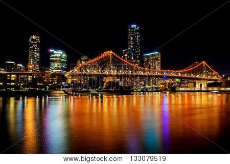 BRISBANE, AUS - MAY 28 2016: Panoramic and vibrant view of Brisbane Skyline with Story Bridge and the river during night