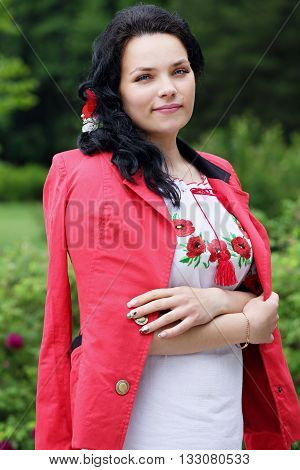 Beautiful bride in a dress with embroidery in Ukrainian style