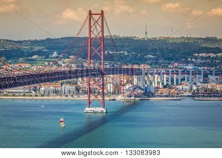 Lisbon Portugal-April 11 2015:The 25 de Abril Bridge is a bridge connecting the city of Lisbon to the municipality of Almada on the left bank of the Tejo river Lisbon