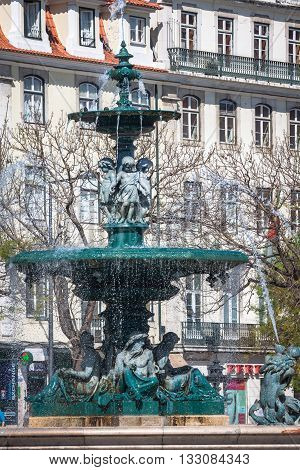 Lisbon Portugal-April 12 2015: Rossio square with fountain located at Baixa district in Lisbon Portugal