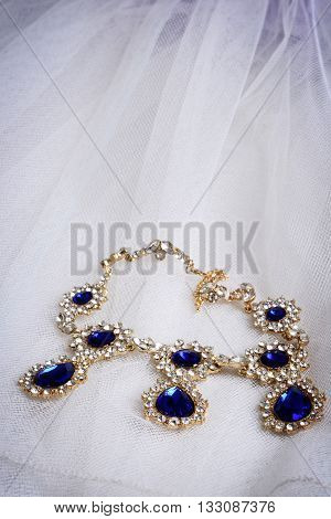 closeup vintage diamond sapphire necklace on lace